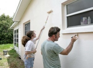 Couple painting house