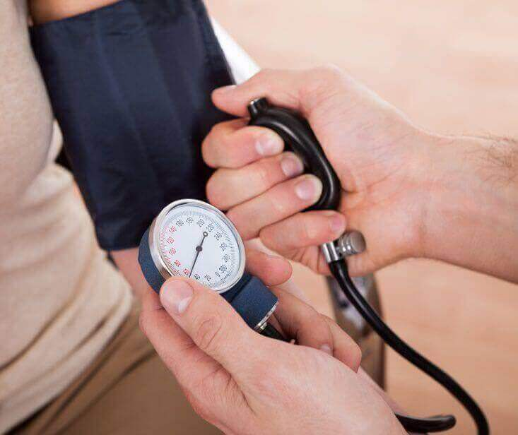 A medical professional taking blood pressure