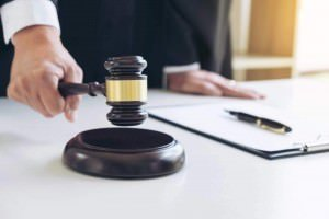 A judge slamming his gavel.